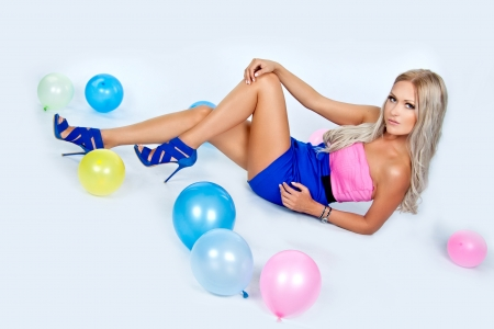 Girl looking happy holding few balloons