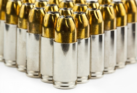 9 mm bullets on a white background isolated Stock Photo - 17600038