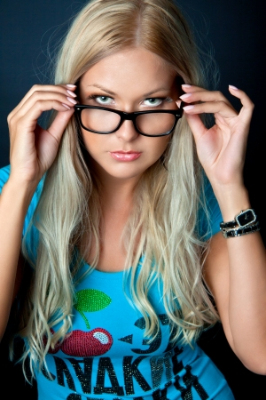 pretty blonde girl: Blonde girl wearing glasses and looking aside