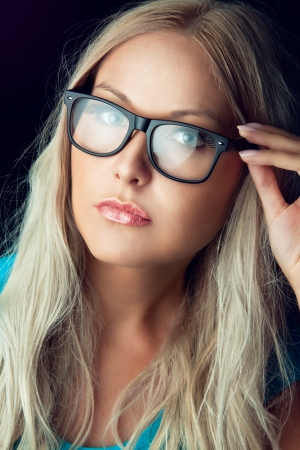 eye glass: Blonde girl wearing glasses and looking aside