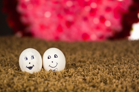 Painted eggs with facial expression shoot intoors photo
