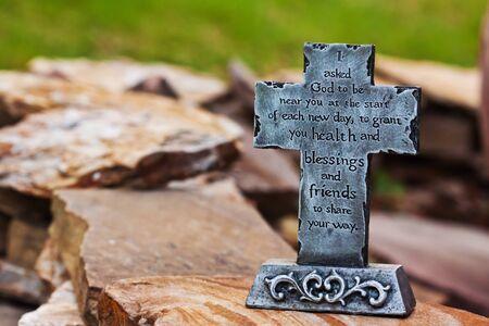 decor: Close up decor of outdoors stone made cross