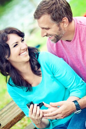 Portraite of a happy couple outdoors in the park  photo