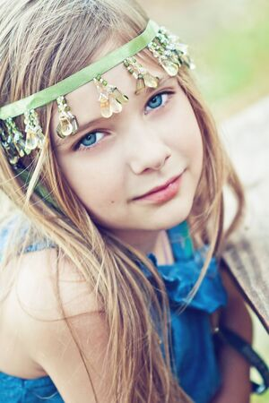 beautiful blonde girl with green eyes: Portrait of a blode girl outdoors in the park