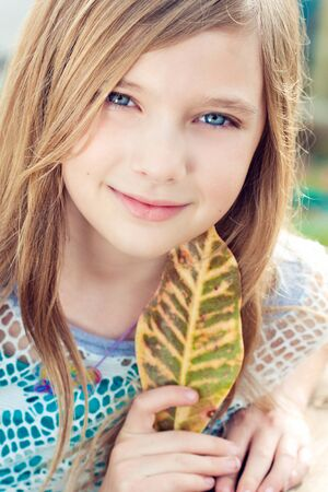 Portrait of a blode girl outdoors in the park  photo