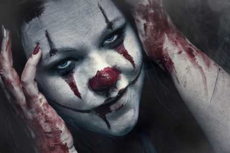 Close up portraite of a scary clown,, make-up special effects photo
