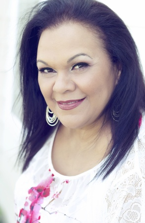 Close up portrait of a pretty hispanic woman in her 50s