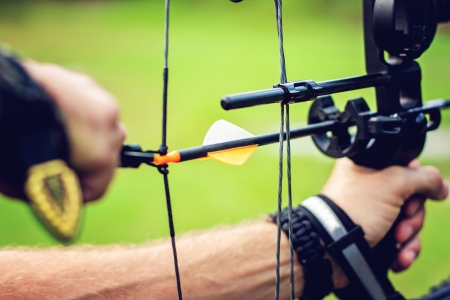 target: Close up picture of an archer with a bow Stock Photo