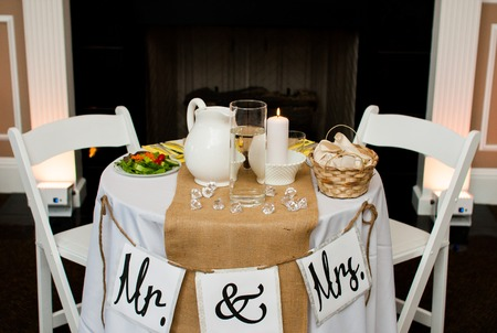 Mr and Mrs table at the wedding indoors photo