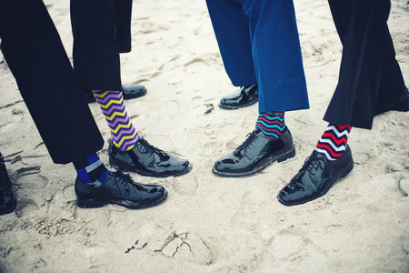 Grooms and groomsmen feet with funny socks Stock Photo