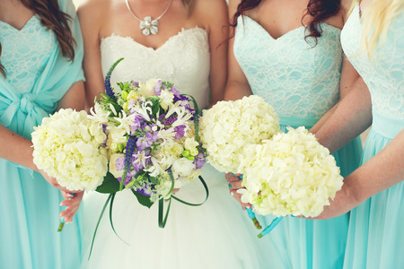 aqua flowers: Close up of bride and bridesmaids bouquets