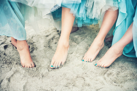 Close of of feet of a bride and her bridesmaids Standard-Bild