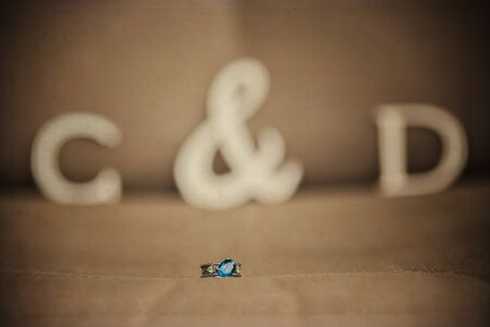 fabric surface: Unique wedding, engagement ring on a fabric surface with a emerald gemstone