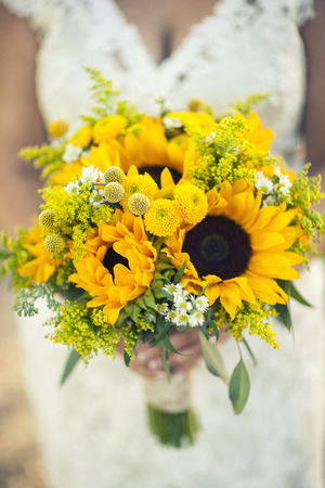 Close of the the bride holding her flowers, bridal bouquet at the wedding
