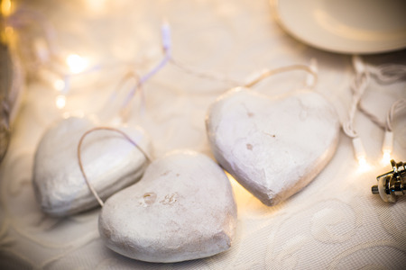 Close up of heart shaped decoration on the background