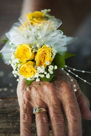 Yellow roses and white flowers on a hand for a wedding
