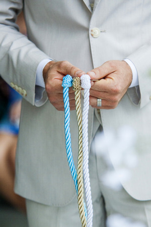 Close up of a Wedding tradition tighting the knot Standard-Bild