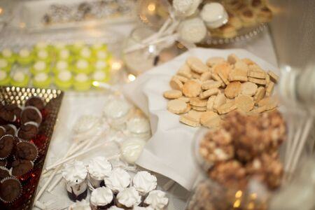 Cookies laying on the table at the event, wedding day Standard-Bild