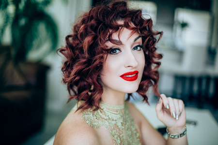 Girl with red short curly hair Фото со стока