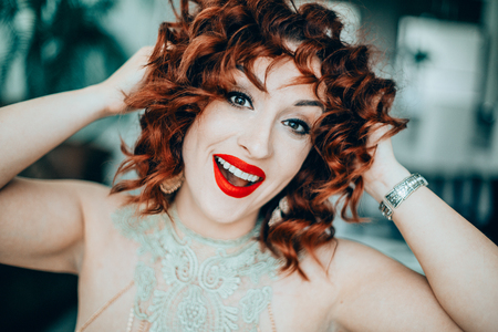 Happy Girl with red short curly hair Standard-Bild