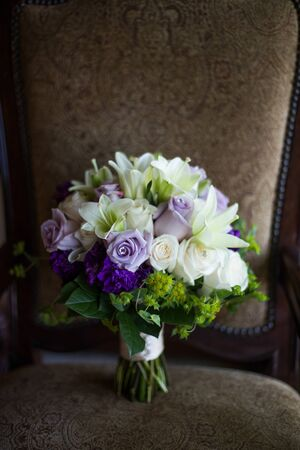 Purple and White Bridal Bouquet on a brown background