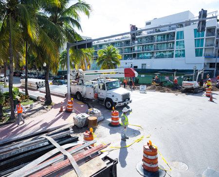 restauration: man at work in collin street, miami Editorial