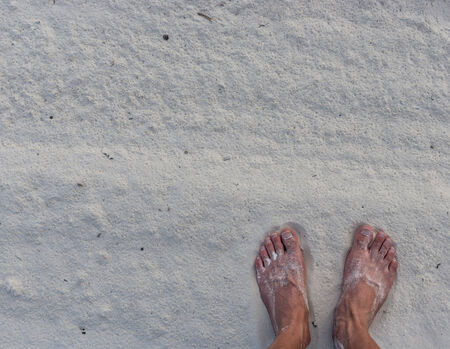 painted toenails: feet in the sand