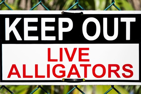 keep out: Keep out,live alligators zone signboard