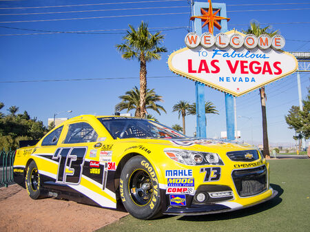lasvegas: LAS VEGAS - DECEMBER 6  Chevrolet racing car number 73 representing the NASCAR championship  in front of the famous  Welcome Sign  on December 6, 2013 in Las Vegas Nascar races are the most followed sport event after Super Bowl  Editorial