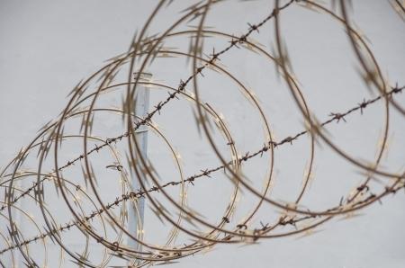 razor wire: Razor wire protection from intruders