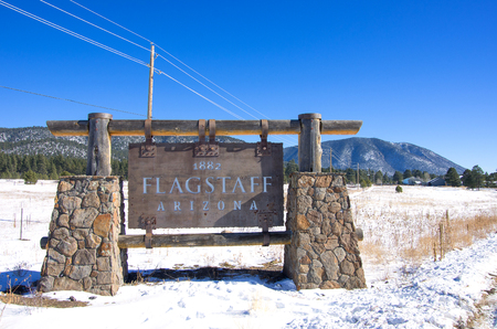 flagstaff: Flagstaff sign with snow,Arizona