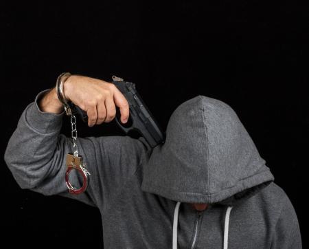 jailbreak: Man pointing the gun at his head Stock Photo
