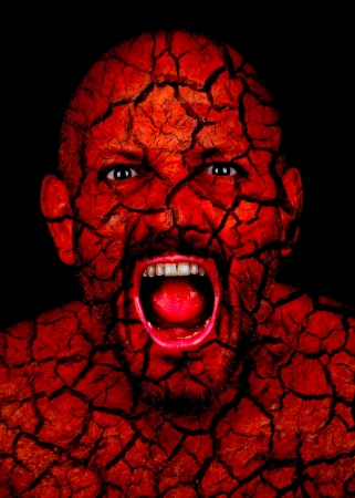 Frightening man with cracked skin looking like a demon or zombie Stock Photo - 25155686
