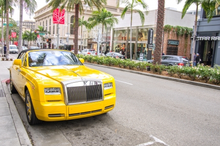 BEVERLY HILLS,CA - DECEMBER 18, 2013  yellow rolls royce at Rodeo Drive,Beverly Hills CA  Rodeo Drive is a shopping district famous for designer label and haute couture fashion
