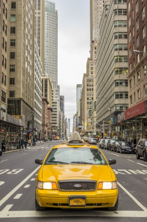 NEW YORK - DECEMBER 22, 2013: yellow taxi in Manhattan,New York. The city is planning to replace its fleet of various kinds of taxis with one model.