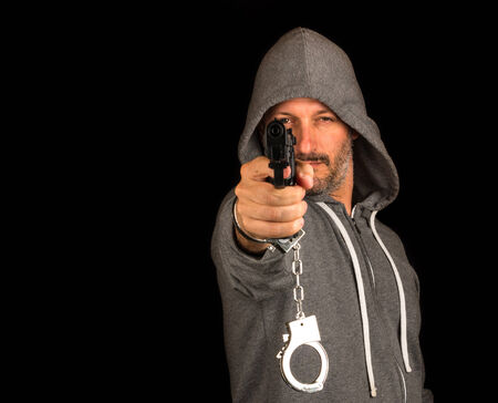 assasin: Criminal free himself from handcuffs and shoots with gun