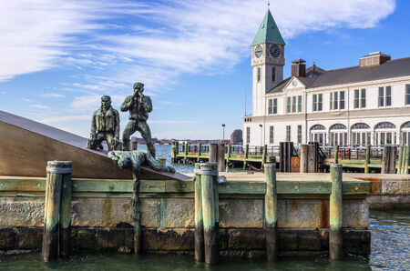 immigrants: Immigrants monument in Battery Park,New York Editorial