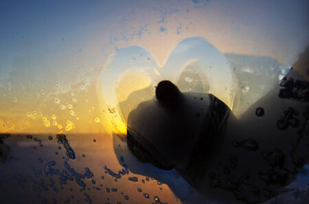 icily: Hand drawing a heart on window