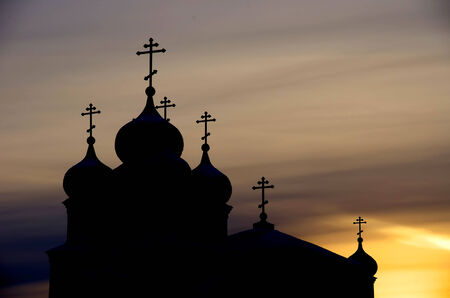 Silhouette of orthodox church at sunset photo