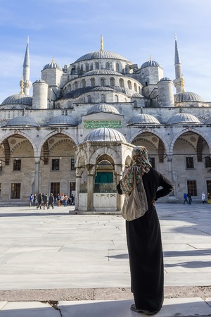 Woman looking the Blue Mosque  Sultanahmet Camii , Istanbul