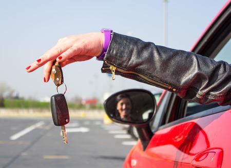 thumb keys: girl holding car keys