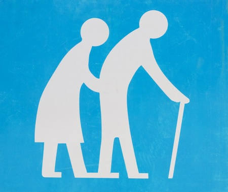 walking stick: Street sign of old couple crossing the road Stock Photo