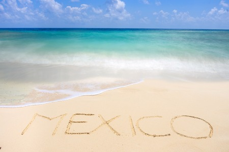 Tropical beach and Mexico writing on sabd Stock Photo