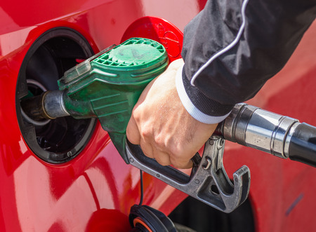 car gas: man put gasoline in the tank