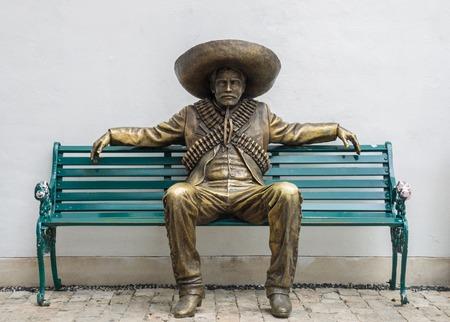 ソンブレロ像とメキシコ人男性 写真素材