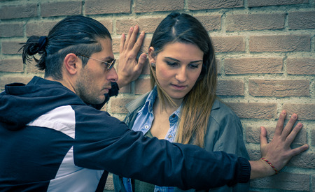 boyfriend abusing his woman photo