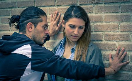 apathy: boyfriend abusing his woman Stock Photo
