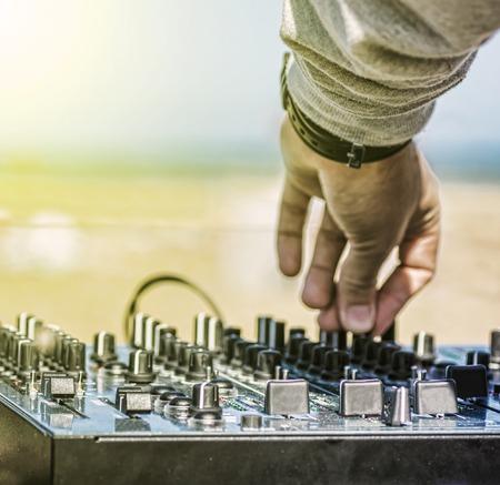 dj music: Dj hands on equipment deck and mixer Stock Photo