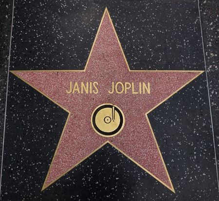 ca: HOLLYWOOD,CA - DECEMBER 19, 2013: Janis Joplin tribute on the Walk of Fame. This star is located on Hollywood Blvd. and is one of 2400 celebrity stars