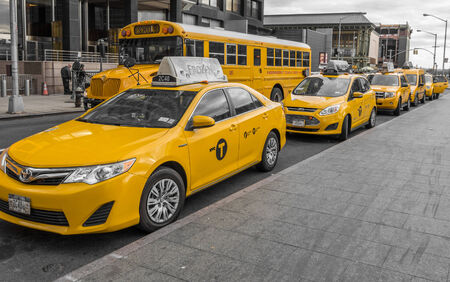 NEW YORK - NOVEMBER 21, 2013: New York taxis waiting for clients.New York City has around 6,000 hybrid taxis